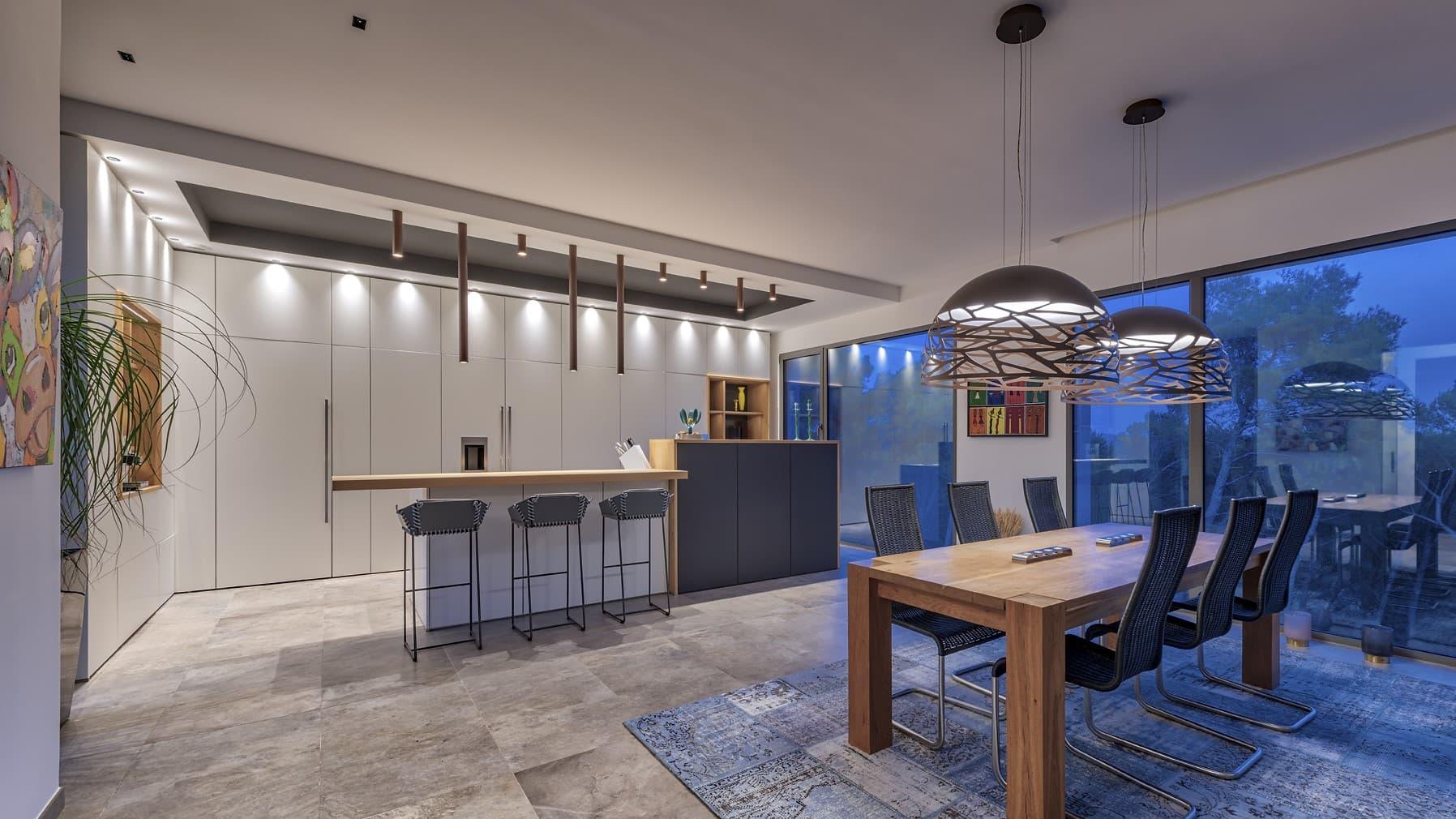 Salle à manger et cuisine de la villa omega avec des suspensions organiques